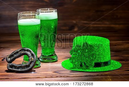 St Patricks Day With Glasses Of Green Beer, Leaf Clover, Light Leprechaun Hat On Vintage Wooden Back