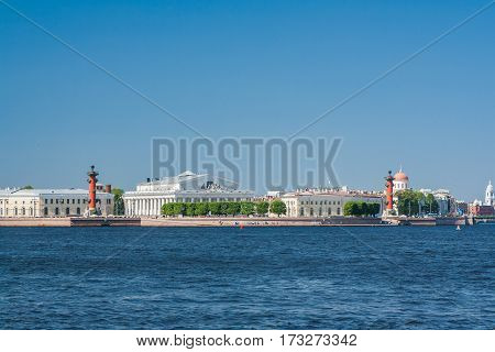 View of St. Petersburg Vasilievsky island. Rostral columns and Exchange building in sunny day. Saint-Petersburg Russia.