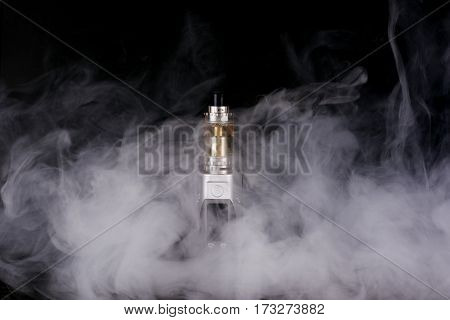 electorinc cigarette and smoke on isolated background