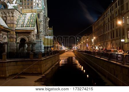 Russia Saint-Petersburg nights, 18 december 2009: The church by the canal. Night view of Griboyedov Canal and Church of the Savior on Blood.