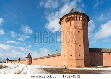 wall with towers in a medieval monastery in winter