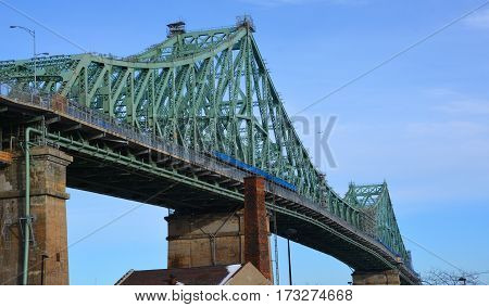 MONTREAL CANADA 02 13 2016:The Jacques Cartier Bridge is a steel truss cantilever bridge crossing the Saint Lawrence River from Montreal to Longueuil in Montreal, Quebec, Canada