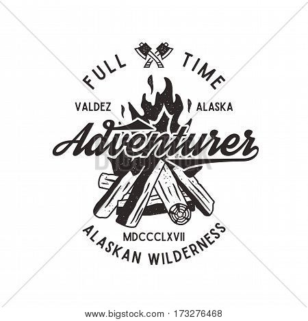 Full time adventurer vintage label with textured bonfire, axe and type elements. Alaska wilderness retro emblem. letterpress effect. Isolated on white background. Stock Vector.
