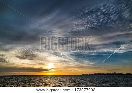Dark clouds over Capo Caccia at sunset Sardinia