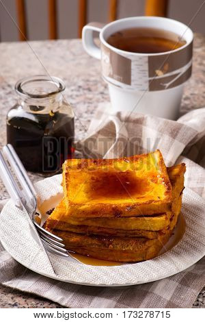 pumpkin french toast with marple syrop..selective focus