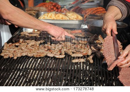 Grilling cevaps or kebabs on a grill at the street market