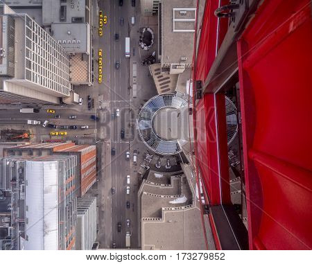 View of 9th Avenue SW  from the glass floor of the Calgary Tower in Calgary, Alberta.  The glass floor is a popular draw at the famous Calgary Tower.