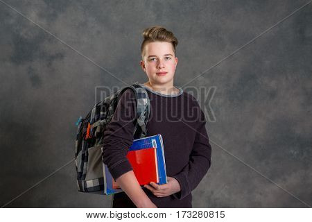 Teenager With Satchel And Books