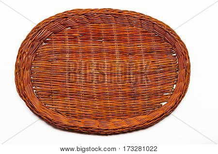 Round wicker basket of brown color on a white background. Handmade
