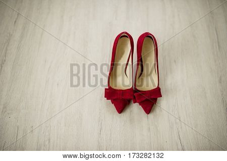 Red Velvet Bride Shoes On Wooden Background.