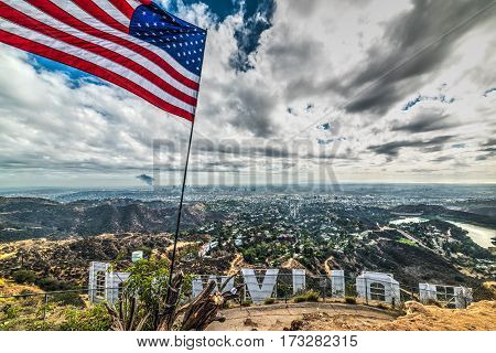 Los Angeles CA USA - October 28 2016: US flag by Hollywood sign