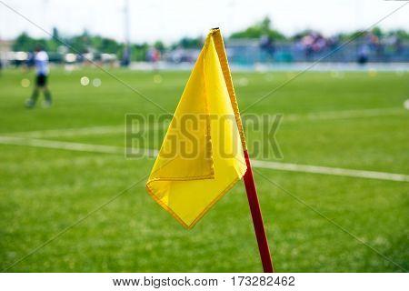 Yellow Soccer Corner Flag. Football Stadium in the Background