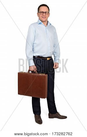 Happy smiling businessman in blue formal shirt blue pants and glasses posing with brown leather briefcase against white background - business people and office concept