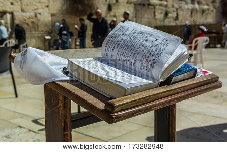Jerusalem, Israel. Western Wall also known as Wailing Wall or Kotel. The Torah Book in the foreground. Passover Jewish