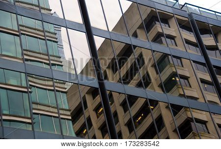 Building Reflections In Glass Walls On West Georgia Street