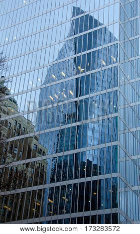 Building Reflections In Glass Walls On Burrard Street