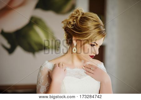 Blonde Bride At Wedding Day On Her Room In Morning.