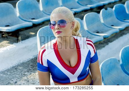 portrait of the sports blonde on steps of stadium a subject of the woman and sport