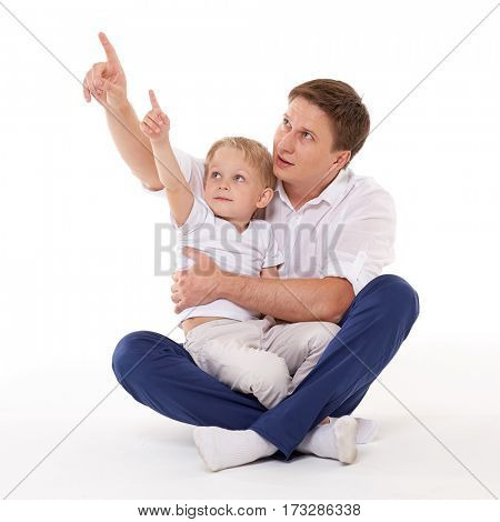 Young happy father with sweet child sit on a white background. Happy family.
