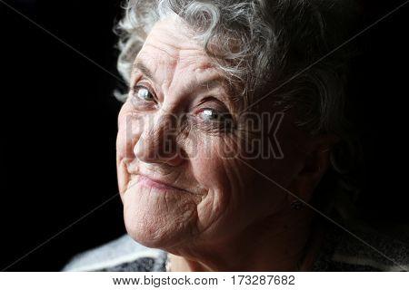 Smile grandmother face on a black background