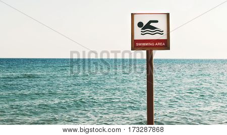 sign can float on the sea beach.