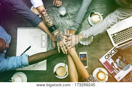 Group of people hand assemble together