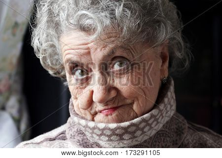 Thinking grandmother face on a dark background