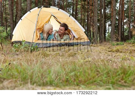 Loving young couple relaxing in tent