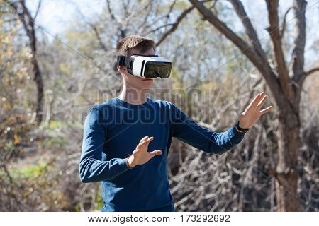 Handsome man wearing future technology virtual reality glasses