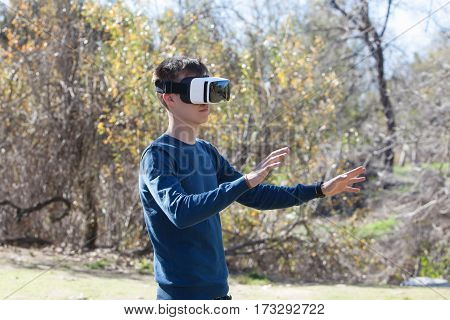 Young man wearing future technology VR glasses
