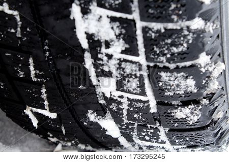 car tire protector in the snow closeup