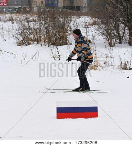 Kirishi, Russia - 11 February, Man running piste, 11 February, 2017. Mass ski race Russian Ski Track.