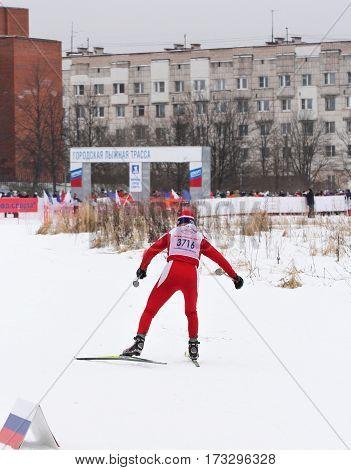Kirishi, Russia - 11 February, An athlete coming to the finish line, 11 February, 2017. Mass ski race Russian Ski Track.