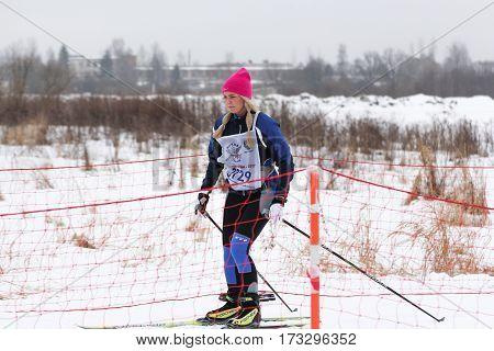Kirishi, Russia - 11 February, Skier on the road between the grids, 11 February, 2017. Mass ski race Russian Ski Track.