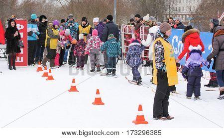 Kirishi, Russia - 11 February, Parents with young children skiing, 11 February, 2017. Mass ski race Russian Ski Track.