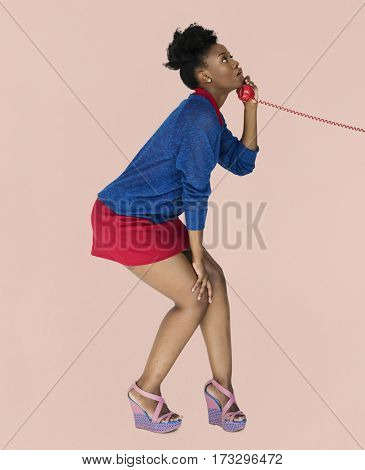 Black woman calling over the phone