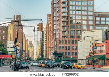 NEW YORK CITY, USA - AUGUST 14, 2016: Buildings and street life on the Broadway.It is the oldest north-south main thoroughfare in New York City, dating to the first New Amsterdam settlement.