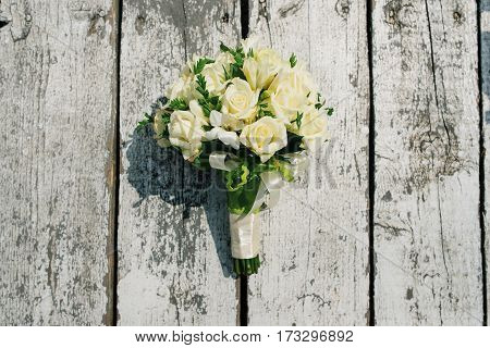 Wedding Bouquet Of White Roses On Wooden Background.