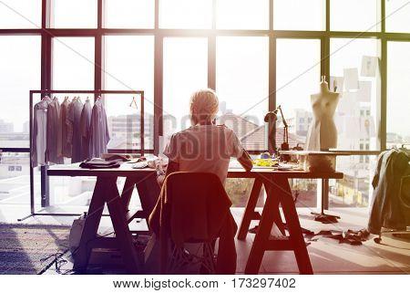 Fashion designer working on her workspace