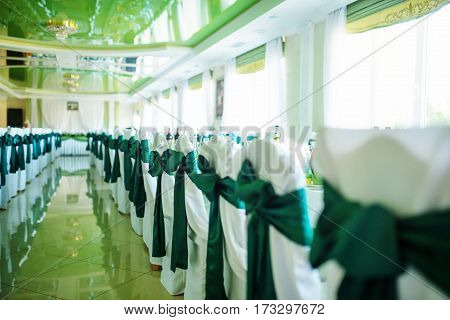 Green Ribbons On Wedding Chairs At Great Hall.