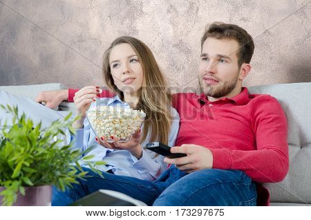 Couple Enjoys Free Time And Watching Tv
