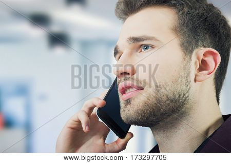 Handsome man talking on the phone. man talking call mobile calling business young concept