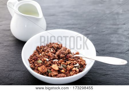 Healthy oat cereals on a wooden surface. Granola