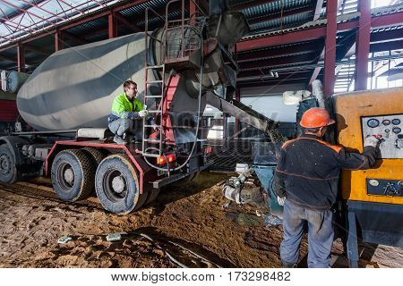 St.-Petersburg, Russia  - 20 february 2017: Construction of a warehouse pouring concrete inside