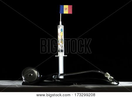 Stethoscope And Syringe Filled With Drugs Injecting The Andorran Flag On A Black Background