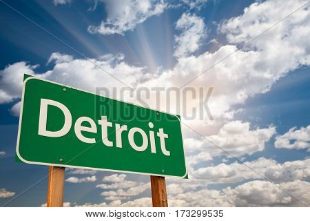 Detroit Green Road Sign Over Dramatic Clouds and Sky.