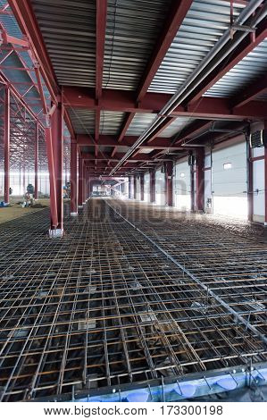 iron structures being built inside a large warehouse