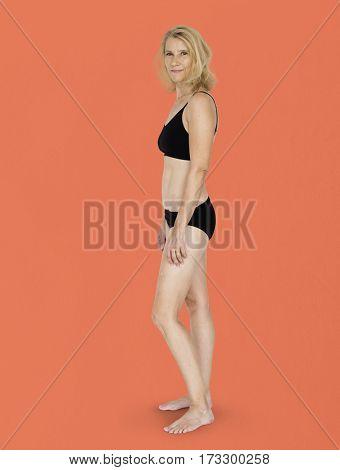 Caucasian Blonde Female Model On Orange Background