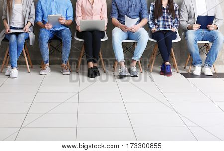 Group of people waiting for job interview in office hall