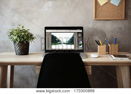 Modern workplace with laptop on table